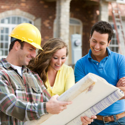 Couple looking at plans with builder